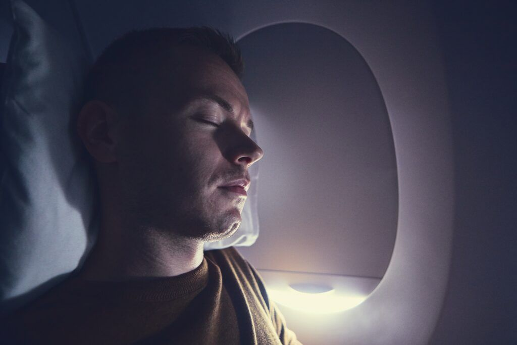 1632435428 586 traveling by airplane young passenger sleeping during flight t20 OpdY1G